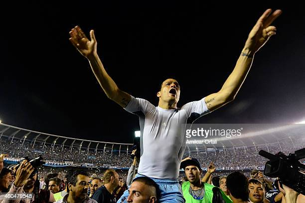 Sebastian Saja of Racing Club celebrates the championship after winning a match between Racing Club and Godoy Cruz as part of 19th round of Torneo de...