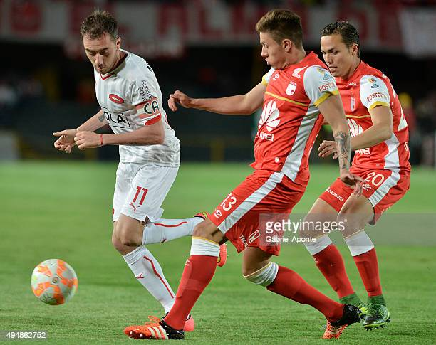Sebastian Salazar of Santa Fe struggles for the ball with Federico Mancuello of Independiente during a second leg Quarter Final match between...