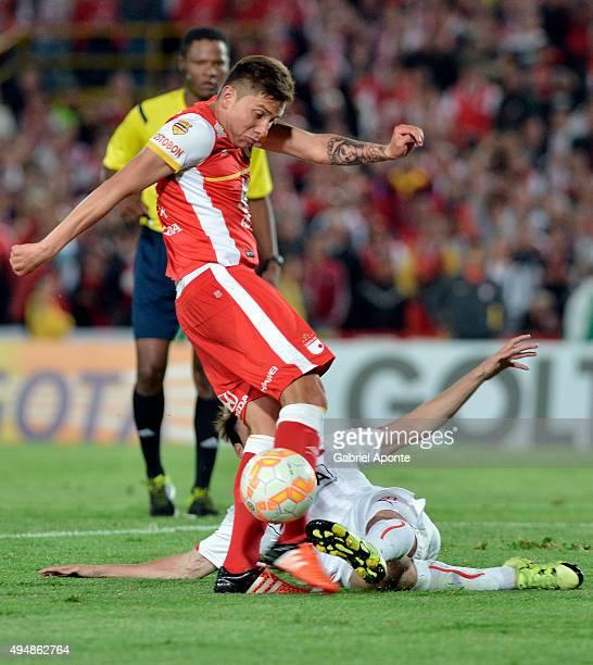 Sebastian Salazar of Santa Fe struggles for the ball with Nicolas Tagliafico of Independiente during a second leg Quarter Final match between...