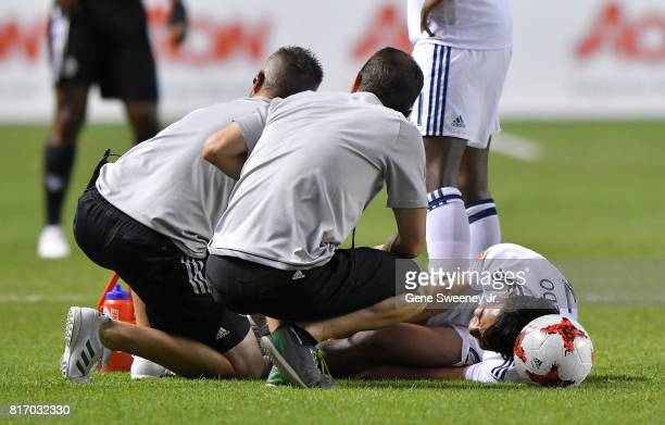 Sebastian Saucedo of Real Salt Lake is attended to after his second half injury during the International friendly game against the Manchester United...