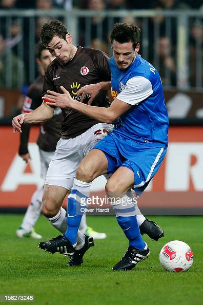 Sebastian Schachten of Pauli and Michael Delura of Bochum battle for the ball during the 2 Bundesliga match between FC St Pauli and VfL Bochum at...
