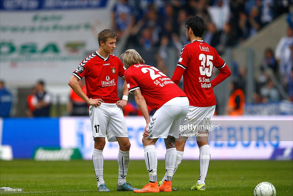 Sebastian Schiek, Kai Gehring and Julian Leist of Sonnenhof-Grossaspach after the Third League match between 1. FC Magdeburg and SG Sonnenhof-Grosssaspach at MDCC-Arena on April 30, 2016 in Magdeburg, Germany.
