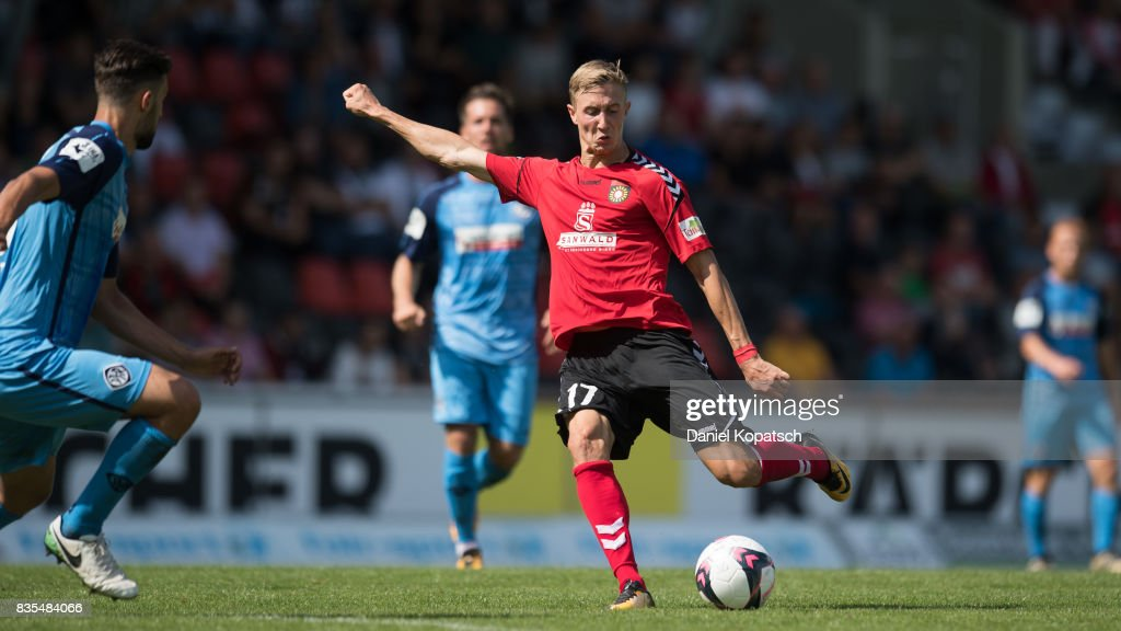 Sebastian Schiek of Grossaspach shoots the ball during the 3. Liga match between SG Sonnenhof Grossaspach and VfR Aalen at on August 19, 2017 in Grossaspach, Germany.