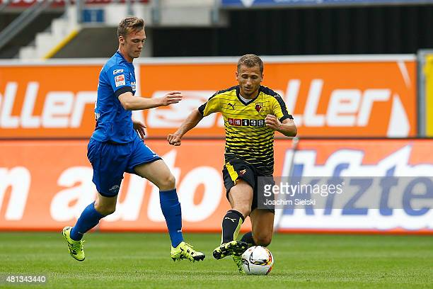Sebastian Schonlau of Paderborn challenges Almen Abdi of Watford during the preseason friendly match between SC Paderborn and Watford FC at Benteler...