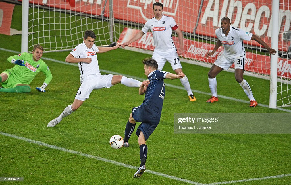 Sebastian Schuppan (FRONT) of Bielefeld misses to score against (L-R) Alexander Schwolow, Marc - Oliver Kempf, <a gi-track='captionPersonalityLinkClicked' href=/galleries/search?phrase=Nicolas+Hoefler&family=editorial&specificpeople=4645206 ng-click='$event.stopPropagation()'>Nicolas Hoefler</a> and Karim Guede of Freiburg during the Second Bundesliga match between Arminia Bielefeld and SC Freiburg at Schueco Arena on March 2, 2016 in Bielefeld, Germany.