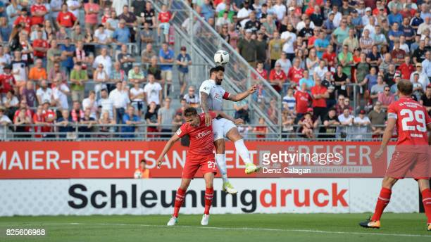 Sebastian Schuppan of Wuerzburg challenges Adriano Grimaldi of Muenster for a header during the 3 Liga match between FC Wuerzburger Kickers and SC...