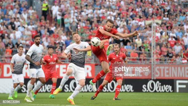 Sebastian Schuppan of Wuerzburg challenges Fabian Menig of Muenster during the 3 Liga match between FC Wuerzburger Kickers and SC Preussen Muenster...