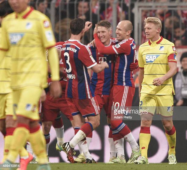 Sebastian Schweinsteiger of Bayern Muenchen is congratulated by Arjen Robben after setting up Sebastian Rode for a goal during the Bundesliga match...