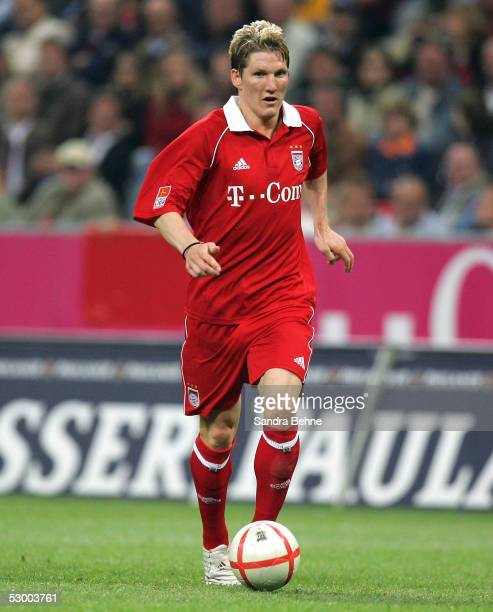 Sebastian Schweinsteiger of Bayern Munich controls the ball during the opening game of the Allianz Arena between Bayern Munich and German Football...
