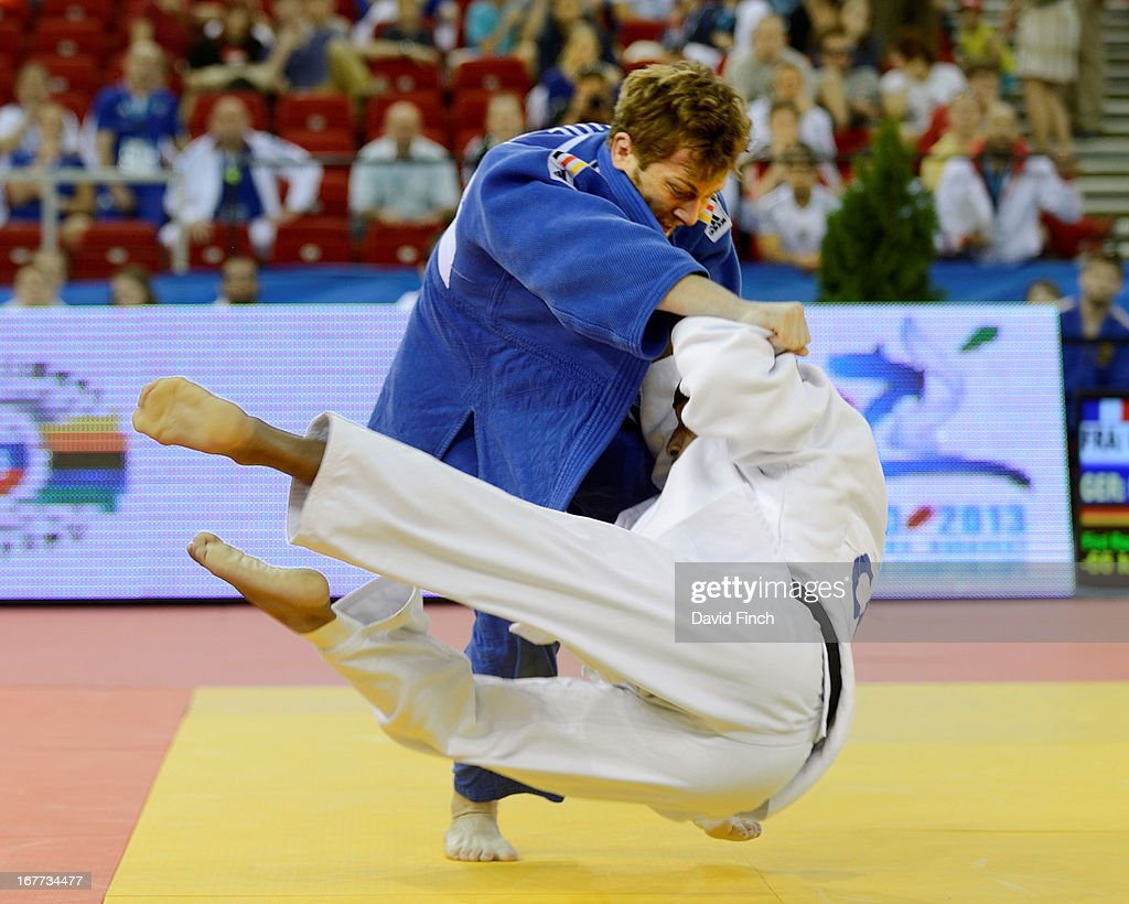 Sebastian Seidl of Germany (blue) sweeps the feet from under David Larose of France for a yuko (5 points) to help Germany defeat France by 4 to 1 at the Budapest European Team Championships held at the Papp Laszlo Sports Hall, on April 28, 2013 Budapest, Hungary.