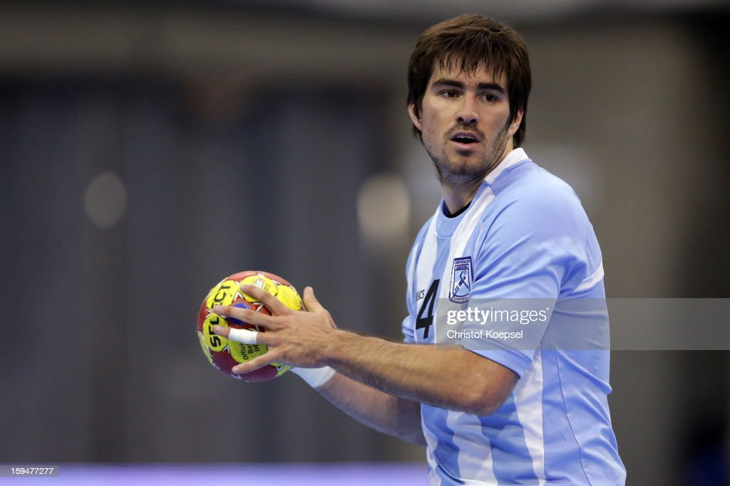 Sebastian Simonet of Argentina passes the ball during the premilary group A match between Brasil and Argentina and Montenegro at Palacio de Deportes de Granollers on January 13, 2013 in Granollers, Spain.
