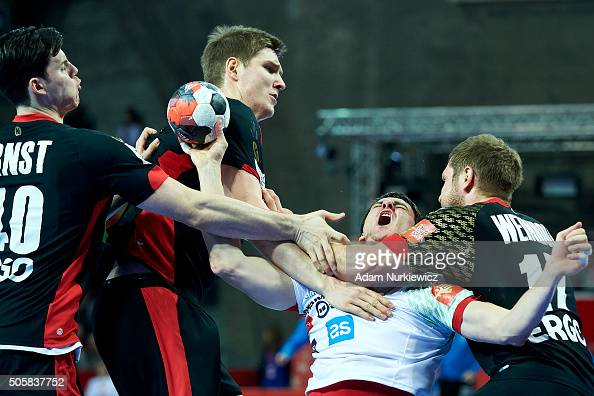 Sebastian Skube of Slovenia fights for the ball with Steffen Weinhold of Germany during the Men's EHF Handball European Championship 2016 match...