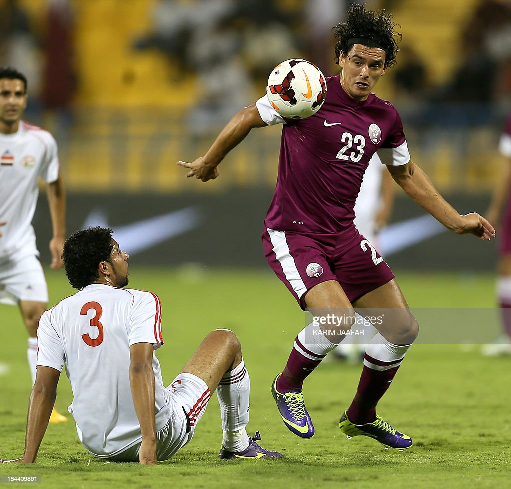Sebastian Soria of Qatar vies for the ball against Mohammed Fuad Omar of Yemen during the two teams 2015 AFC Asian Cup group D qualifying football...