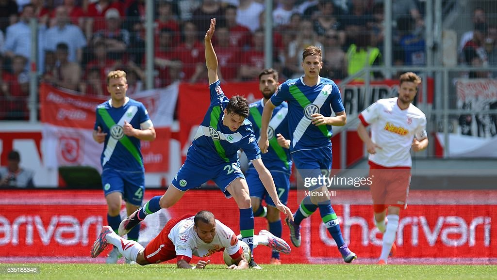 Sebastian Stolze (2nd L) of Wolfsburg and Jann George of Regensburg tussle for the ball during the Third League play off second leg match between Jahn Regensburg and VfL Wolfsburg II at Continental Arena on May 29, 2016 in Regensburg, Germany.