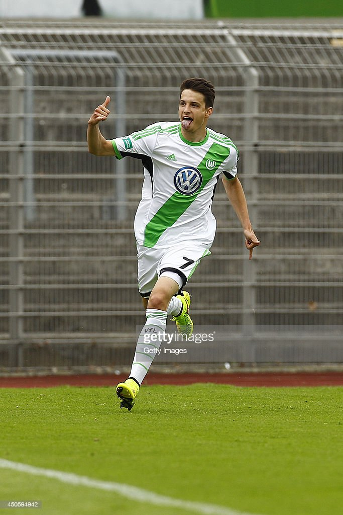 Sebastian Stolze of Wolfsburg celebrates after after scoring a goal (1:0) during the A Juniors Bundesliga semi final between U19 VfL Wolfsburg and U19 Hannover 96 at Stadion am Elsterweg on June 14, 2014 in Wolfsburg, Germany.