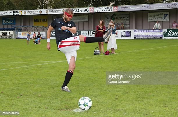 Sebastian Stroebel plays blind soccer penalty kick during the charity football game 'Kick for Kids' to benefit 'Die Seilschaft zusammen sind wir...