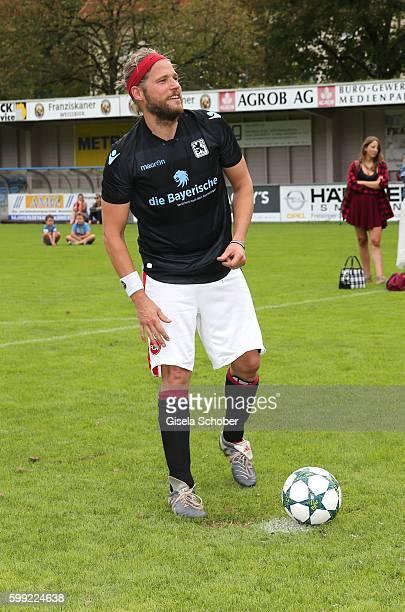 Sebastian Stroebel plays soccer penalty kick during the charity football game 'Kick for Kids' to benefit 'Die Seilschaft zusammen sind wir stark eV'...