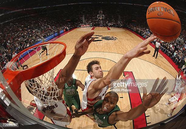 Sebastian Telfair of the Boston Celtics has a shot blocked by Andrea Bargnani of the Toronto Raptors in NBA action December 1 2006 at the Air Canada...