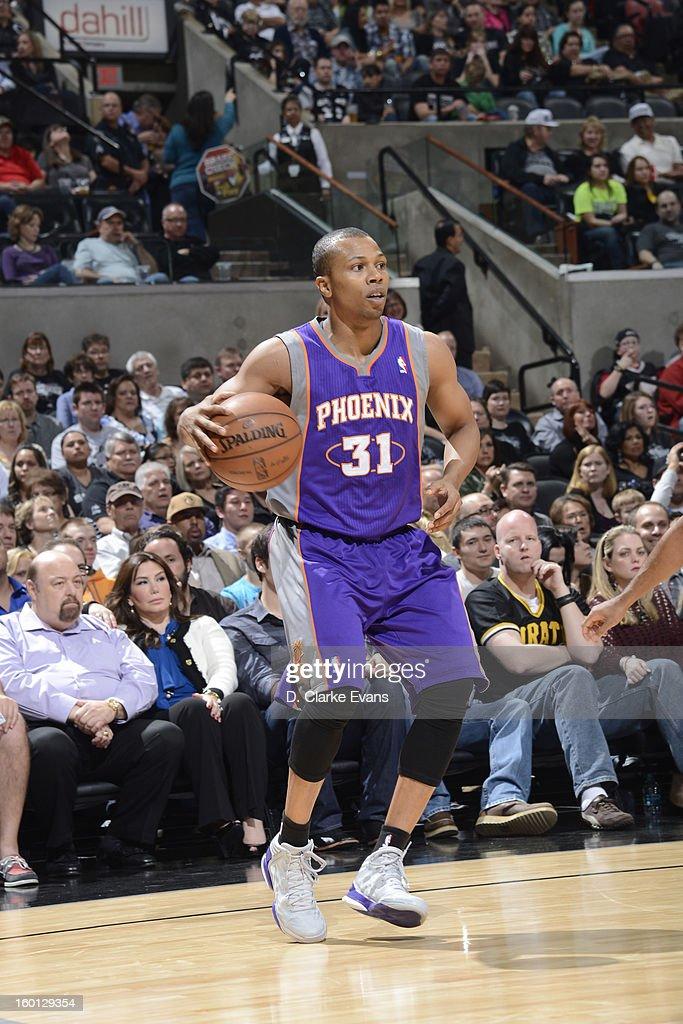 Sebastian Telfair #31 of the Phoenix Suns controls the ball against the San Antonio Spurs on January 26, 2013 at the AT&T Center in San Antonio, Texas.