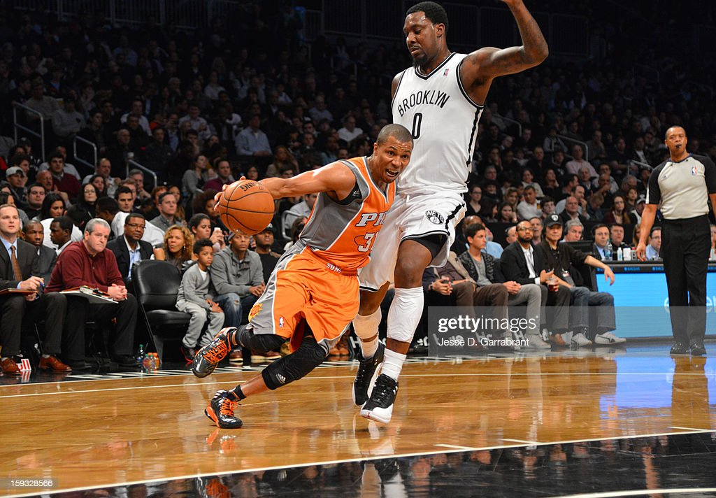 Sebastian Telfair #31 of the Phoenix Suns dribbles to the basket against Andray Blatche #0 of the Brooklyn Nets during the game at the Barclays Center on January 11, 2013 in Brooklyn, New York.