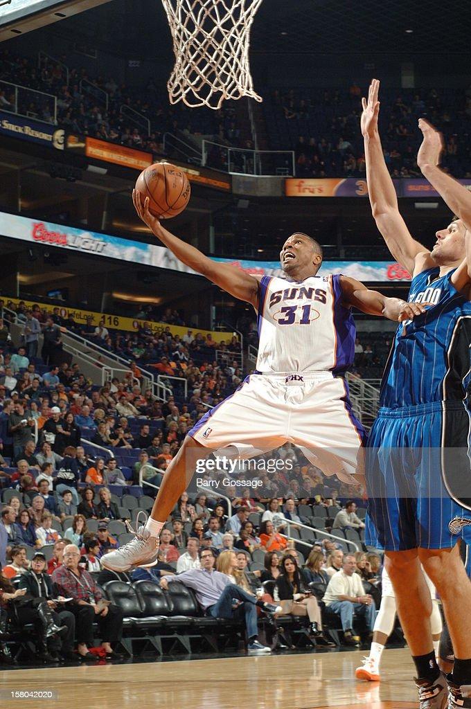 Sebastian Telfair #31 of the Phoenix Suns drives for a shot against the Orlando Magic on December 9, 2012 at U.S. Airways Center in Phoenix, Arizona.