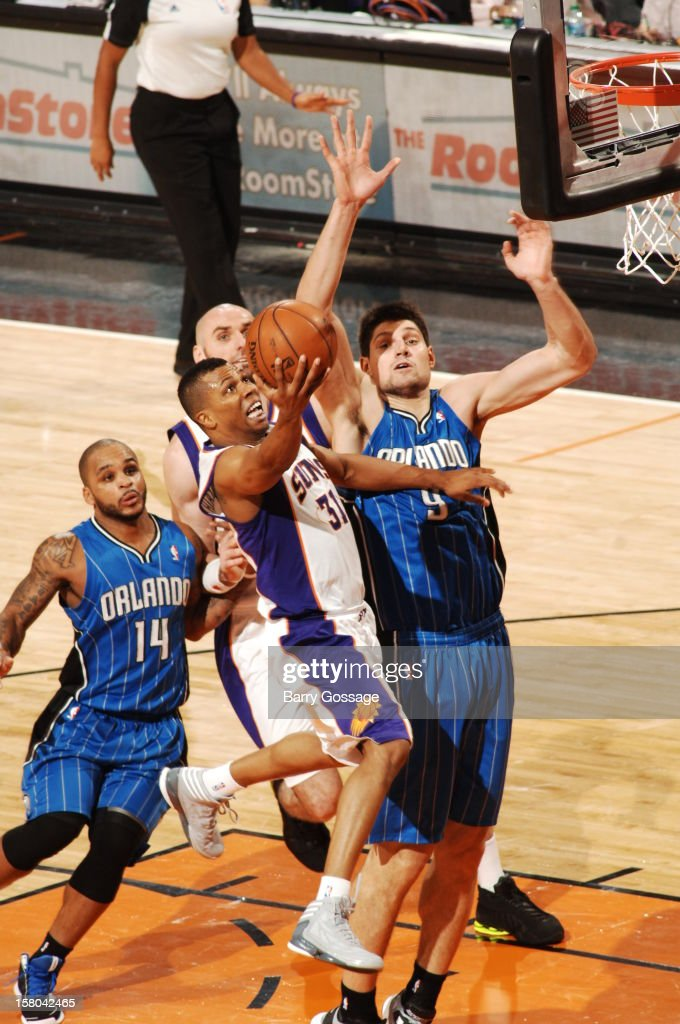 Sebastian Telfair #31 of the Phoenix Suns drives for a shot past Nikola Vucevic #9 of the Orlando Magic on December 9, 2012 at U.S. Airways Center in Phoenix, Arizona.