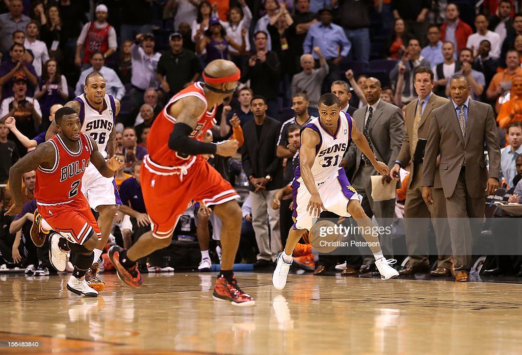 <a gi-track='captionPersonalityLinkClicked' href=/galleries/search?phrase=Sebastian+Telfair&family=editorial&specificpeople=202087 ng-click='$event.stopPropagation()'>Sebastian Telfair</a> #31 of the Phoenix Suns drives the ball upcourt against Richard Hamilton #32 of the Chicago Bulls during the NBA game at US Airways Center on November 14, 2012 in Phoenix, Arizona. The Bulls defeated the Suns 112-106 in overtime.