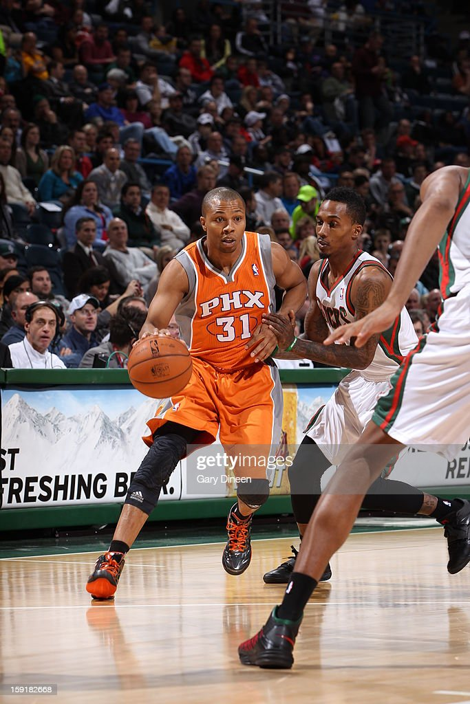 <a gi-track='captionPersonalityLinkClicked' href=/galleries/search?phrase=Sebastian+Telfair&family=editorial&specificpeople=202087 ng-click='$event.stopPropagation()'>Sebastian Telfair</a> #31 of the Phoenix Suns handles the ball against Brandon Jennings #3 of the Milwaukee Bucks on January 8, 2013 at the BMO Harris Bradley Center in Milwaukee, Wisconsin.
