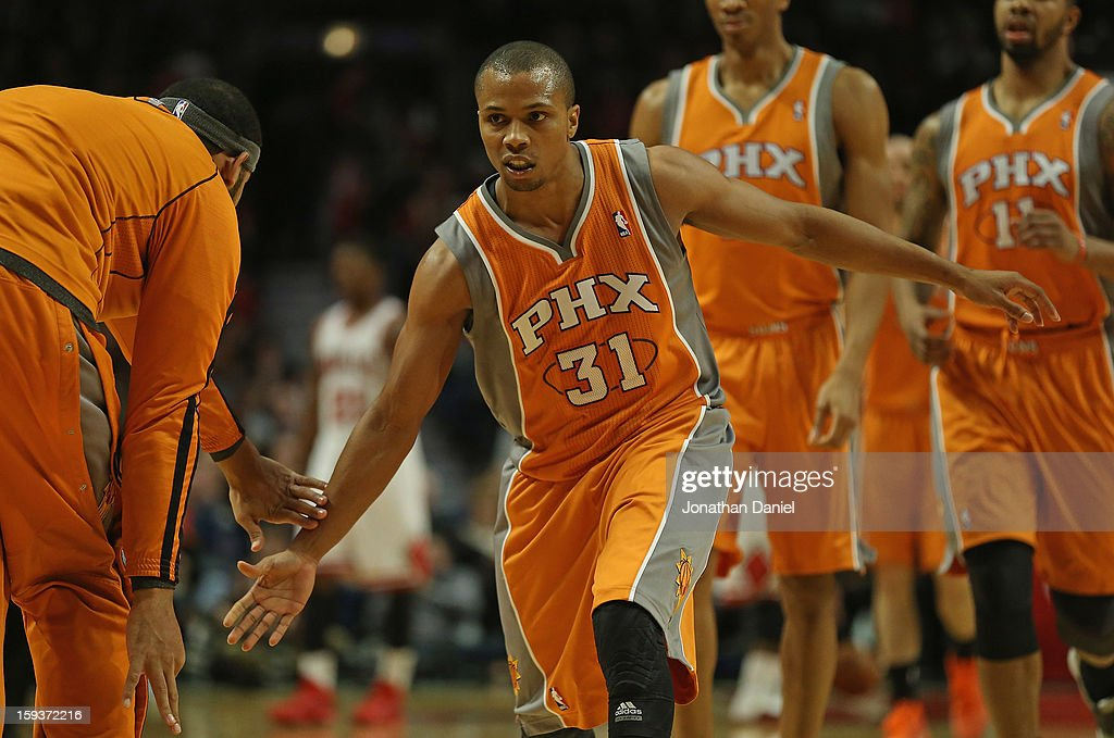 <a gi-track='captionPersonalityLinkClicked' href=/galleries/search?phrase=Sebastian+Telfair&family=editorial&specificpeople=202087 ng-click='$event.stopPropagation()'>Sebastian Telfair</a> #31 of the Phoenix Suns is congratulated by teammates as he leaves the floor during a time-out against the Chicago Bulls at the United Center on January 12, 2013 in Chicago, Illinois. The Suns defeated the Bulls 97-81.