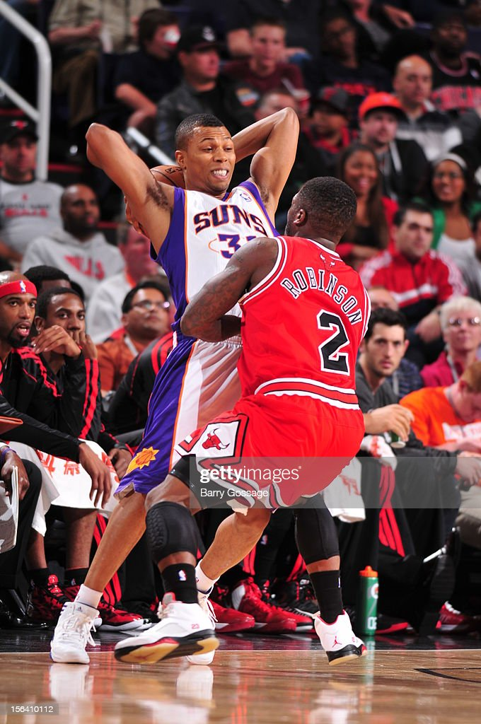 Sebastian Telfair #31 of the Phoenix Suns is guarded by Nate Robinson #2 on November 14, 2012 at U.S. Airways Center in Phoenix, Arizona.