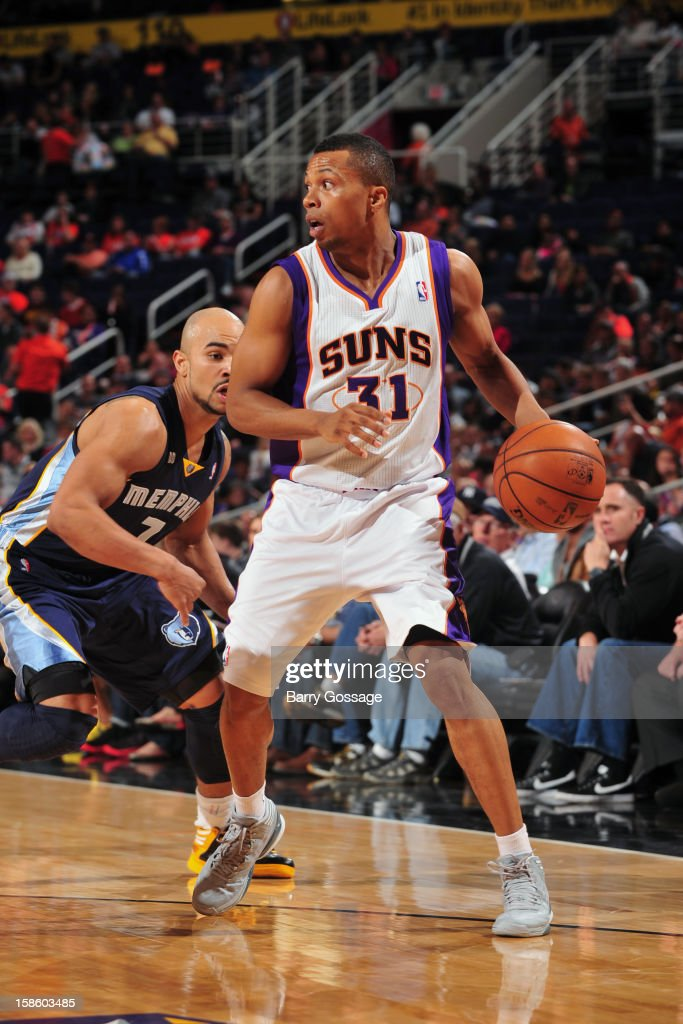 <a gi-track='captionPersonalityLinkClicked' href=/galleries/search?phrase=Sebastian+Telfair&family=editorial&specificpeople=202087 ng-click='$event.stopPropagation()'>Sebastian Telfair</a> #31 of the Phoenix Suns looks to pass the ball against the Memphis Grizzlies on December 12, 2012 at U.S. Airways Center in Phoenix, Arizona.