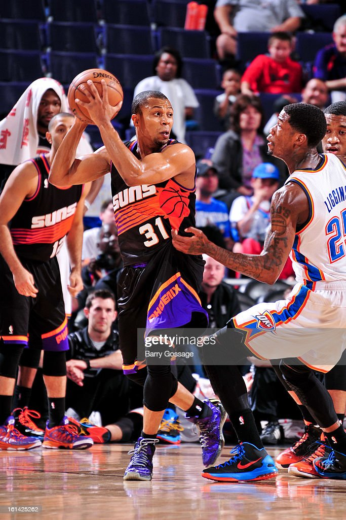 Sebastian Telfair #31 of the Phoenix Suns looks to pass the ball against DeAndre Liggins #25 of the Oklahoma City Thunder on February 10, 2013 at U.S. Airways Center in Phoenix, Arizona.