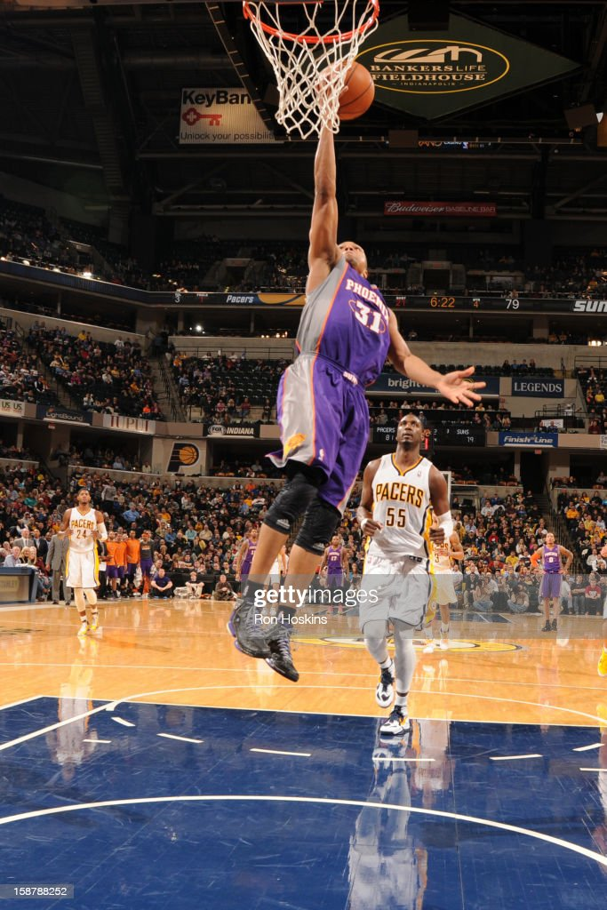 Sebastian Telfair #31 of the Phoenix Suns rises for a layup against Roy Hibbert #55 of the Indiana Pacers on December 28, 2012 at Bankers Life Fieldhouse in Indianapolis, Indiana.
