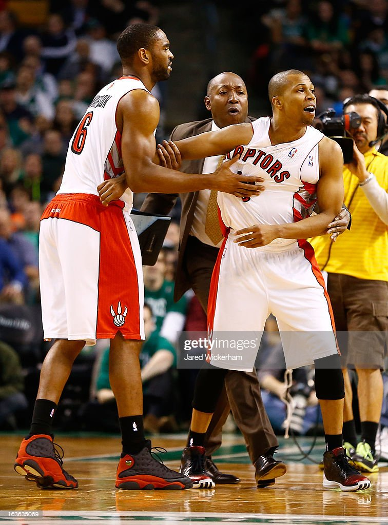 Sebastian Telfair #13 of the Toronto Raptors is held back by teammates and coaches after being thrown out of the game for arguing with referee Kenny Mauer during the game against the Boston Celtics on March 13, 2013 at TD Garden in Boston, Massachusetts.