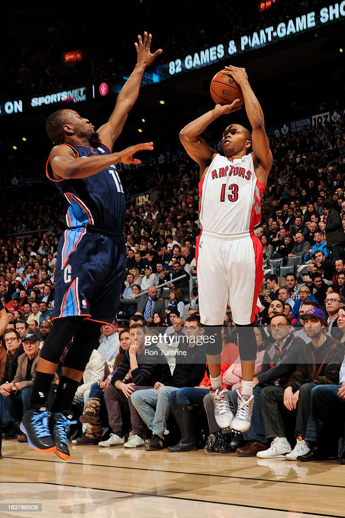 Sebastian Telfair #13 of the Toronto Raptors shoots a three-pointer against Kemba Walker #15 of the Charlotte Bobcats on March 15, 2013 at the Air Canada Centre in Toronto, Ontario, Canada.