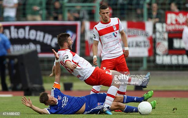 Sebastian Tyrala of Erfurt is challenged by Benjamin Schwarz of Unterhaching during the Third League match between FC Rot Weiss Erfurt and SpVgg...