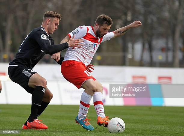 Sebastian Tyrala of Erfurt is challenged by Marcel Franke of Halle during the Third League match between FC Rot Weiss Erfurt and Hallescher FC at...