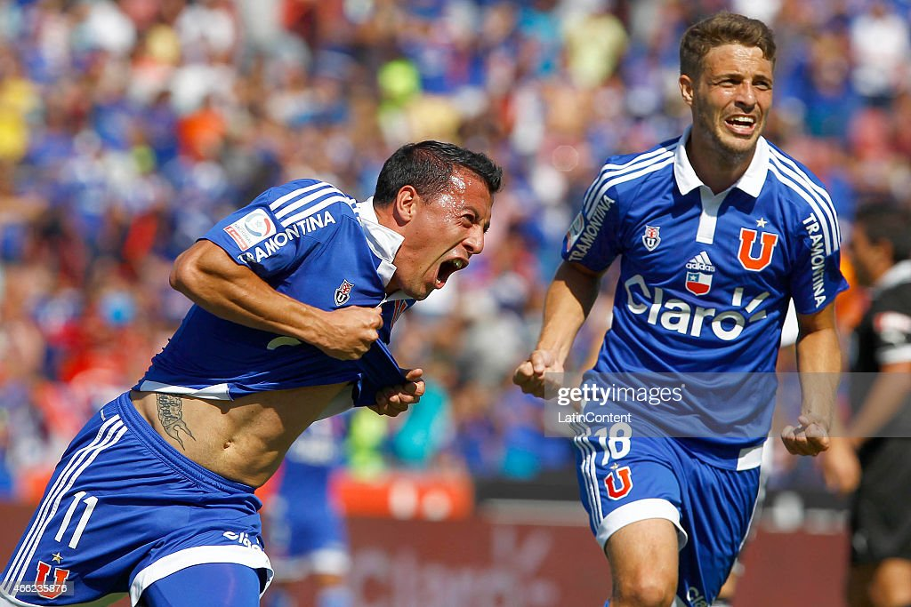 Sebastian Ubilla (L) and Maximiliano Rodriguez (R) of Universidad de Chile celebrate after scoring the first goal of his team during a match between U de Chile and Colo Colo as part of round 11 of Torneo Clausura 2015 at Julio Martinez Pradanos Nacional Stadium on March 14, 2015 in Buenos Aires, Argentina.