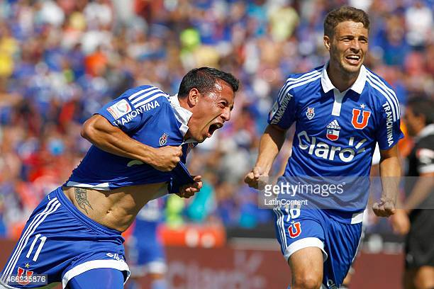 Sebastian Ubilla and Maximiliano Rodriguez of Universidad de Chile celebrate after scoring the first goal of his team during a match between U de...