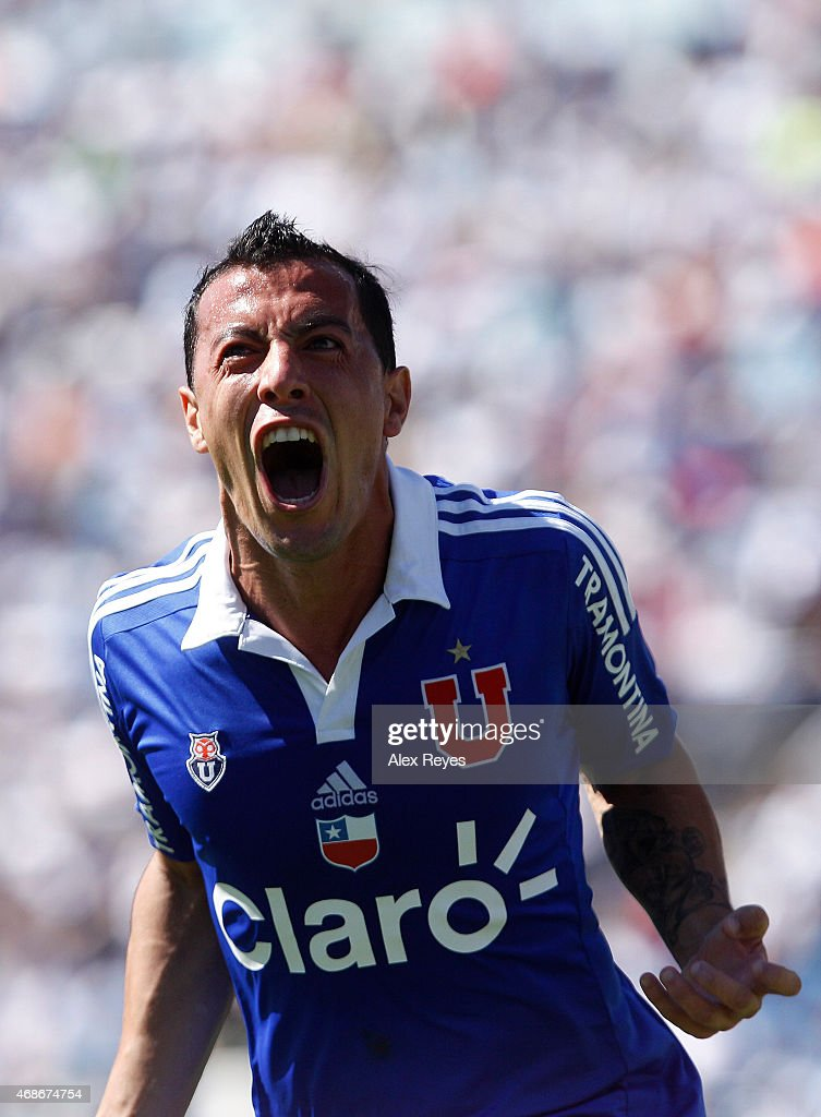 Sebastian Ubilla of U de Chile celebrates after scoring the third goal of his team against U Catolica during a match between U Catolica and U de Chile as part of thirteenth round of Torneo Scotiabank Clausura 2015 at San Carlos de Apoquindo Stadium on April 05, 2015 in Santiago, Chile.