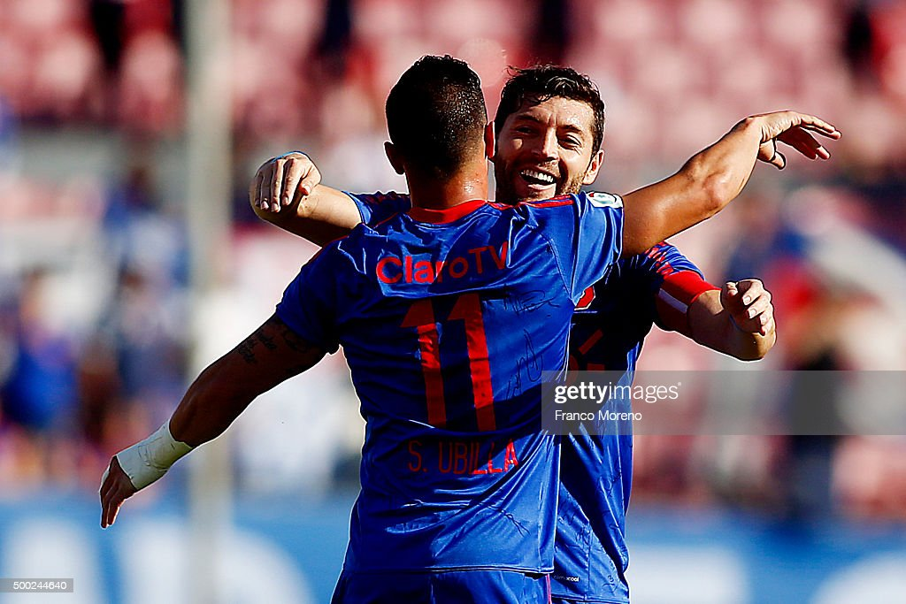 Sebastian Ubilla of U de Chile celebrates with teammates after scoring the first goal of his team during a match between U de Chile and Huachipato as a part of 15 round of Torneo Apertura 2015 at Nacional Julio Martinez Pradanos Stadium on December 5, 2015, in Santiago, Chile.