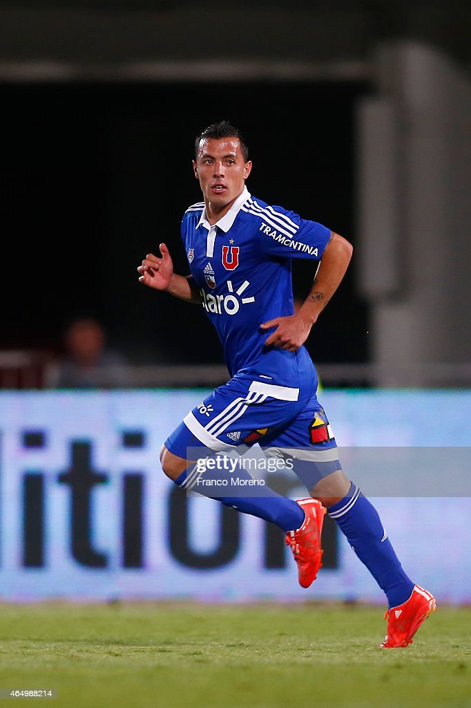 Sebastian Ubilla of Universidad de Chile celebrates after scoring the second goal of his team against Audax Italiano during a match between U de Chile and Audax Italiano as a part of round 9 of Torneo Scotiabank Clausura 2015 at Nacional Julio Martinez Pradanos Stadium on March 02, 2015, in Santiago, Chile.