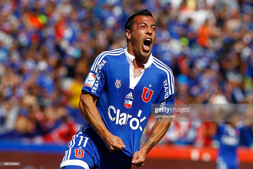 Sebastian Ubilla of Universidad de Chile celebrates after scoring the first goal of his team during a match between U de Chile and Colo Colo as part of round 11 of Torneo Clausura 2015 at Julio Martinez Pradanos Nacional Stadium on March 14, 2015 in Buenos Aires, Argentina.