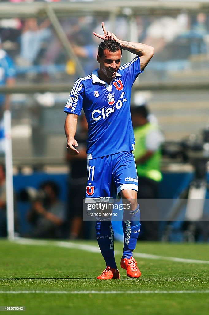 Sebastian Ubilla of Universidad de Chile celebrates the third goal against U Catolica during a match between U Catolica and Universidad de Chile as part of thirteenth round of Torneo Scotiabank Clausura 2015 at San Carlos de Apoquindo Stadium on April 05, 2015, in Santiago, Chile.