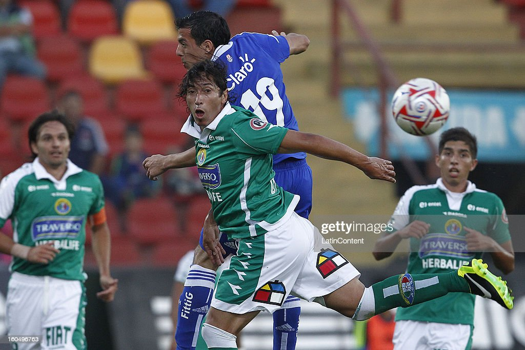 Sebastian Ubilla of Universidad de Chile fights for the ball with Cristian Oviedo of Audax Italiano during a match between Universidad de Chile and Audax Italiano as part of the Torneo Transición 2013 at Santa Laura Stadium on February 01, 2013 in Santiago, Chile.