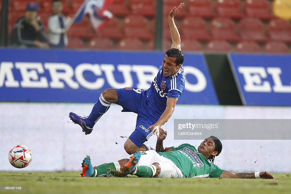 Sebastian Ubilla of Universidad de Chile fights for the ball with Mauricio Arias of Audax Italiano during a match between Universidad de Chile and Audax Italiano as part of the Torneo Transición 2013 at Santa Laura Stadium on February 01, 2013 in Santiago, Chile.