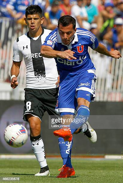Sebastian Ubilla of Universidad de Chile kicks the ball to score the first goal during a match between U de Chile and Colo Colo as part of round 11...