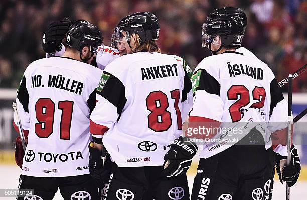 Sebastian Uvira of Koelner Haie celebrates with team mates as he scores the opening goal during the Ice Hockey DEL match between Duesseldorfer EG and...