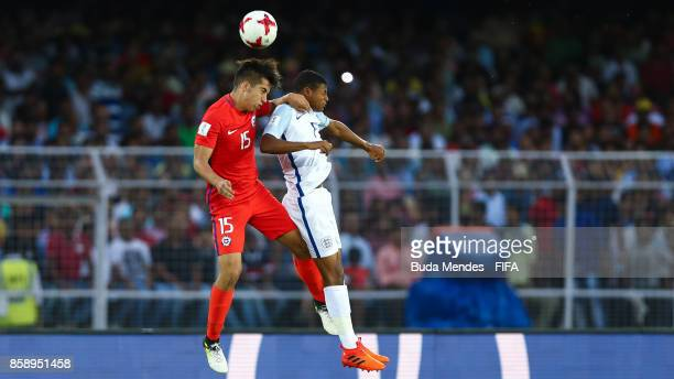 Sebastian Valencia of Chile battles for the ball with Rhian Brewster of England during the FIFA U17 World Cup India 2017 group F match between Chile...