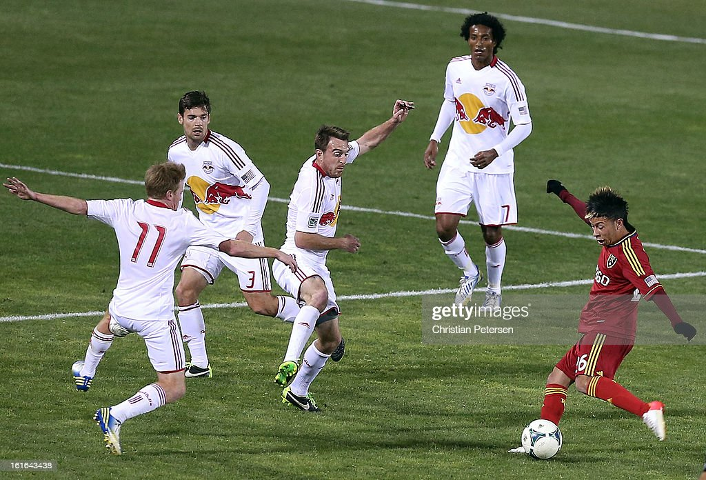 Sebastian Velasquez #26 of Real Salt Lake shoots the ball against Dax McCarty #11 of the New York Red Bulls during the second half of the FC Tucson Desert Diamond Cup at Kino Sports Complex on February 13, 2013 in Tucson, Arizona.